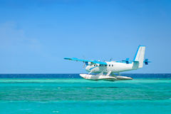 Seaplane taking off over ocean Stock Photos