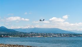 Seaplane taking off over Vancouver bay - BC, Canada Royalty Free Stock Photography