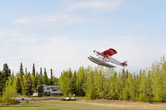 Seaplane taking off from river Royalty Free Stock Images