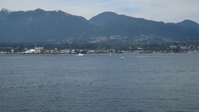 A seaplane is taking off from the sea. Burrard Inlet Vancouver BC Canada stock video footage