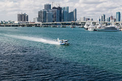 Seaplane Taxiing Past Miami Stock Image