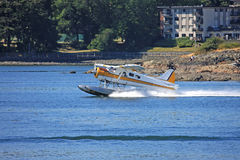Seaplane taxiing for take off Royalty Free Stock Photo