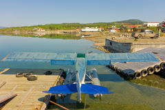 A seaplane tied to a dock at a lake in northern canada Stock Photos