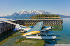 A seaplane tied to a dock in northern bc Royalty Free Stock Photo