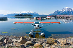 A seaplane tied to the shore at the tiny village of atlin Royalty Free Stock Photos
