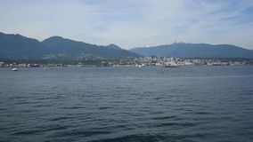 A seaplane is touching down to the sea. Burrard Inlet Vancouver BC Canada stock video