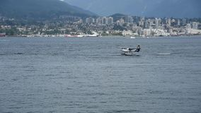 A seaplane is touching down to the sea. stock video