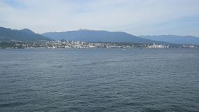 A seaplane is touching down to the sea. Burrard Inlet Vancouver BC Canada stock footage