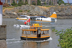 Seaplane and Water Taxi Royalty Free Stock Photos