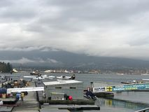 Seaplanes docking on Vancouver Harbour.  stock photo