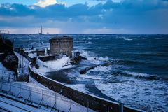 Seapoint Martello Tower. Dun Laoghaire. county Dublin. Ireland. Seapoint Martello Tower covered with snow during storm Emma, Dun Laoghaire. county Dublin Stock Image
