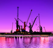 Seaport. Urban night view of the shipyards with cranes Stock Photo