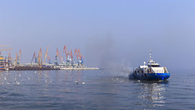 Seaport in Baku and pleasure boat royalty free stock image