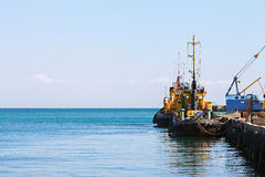 Seaport, barge, tug boat Stock Images