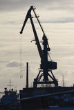 Seaport crane at sunny winter day, Silhouette Stock Image
