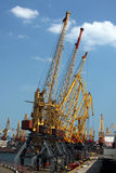 Seaport cranes. Cargo seaport cranes over blue sky, Odessa Royalty Free Stock Images