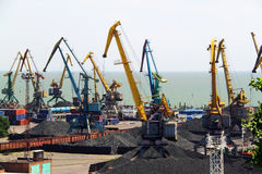 Seaport with cranes and coal Royalty Free Stock Images