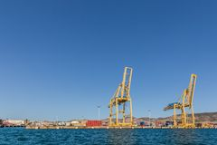 Seaport with cranes and containers Stock Photos