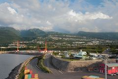 Seaport at foot of mountains. Zone Industrielle ZI, Reunion stock image