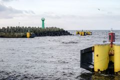 Seaport in Kołobrzeg. Breakwater, view of the lanterns seen fro royalty free stock photos