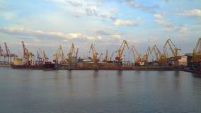 Seaport lit the evening sun Visible cranes, ship, sky with clouds. Seaport lit the evening sun. Visible cranes, ship, sky with clouds stock video footage