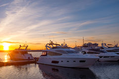 Seaport  with mooring boats at sunset in Sochi, Russia. Seaport with mooring boats at sunset in Sochi, Russia Royalty Free Stock Images