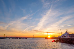 Seaport  with mooring boats at sunset in Sochi, Russia. Seaport with mooring boats at sunset in Sochi, Russia Royalty Free Stock Photo