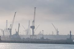 Seaport in the morning. Port cranes, sea-crafts Stock Photography