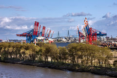 Seaport of Rotterdam, Holland, Netherlands.Loading cranes Royalty Free Stock Photography