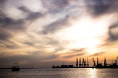 Seaport in the sunset rays of the sun. ship on the horizon at sunset. Travel on Turkey - cityscape of Istanbul with silhouettes of transport at sundown royalty free stock image