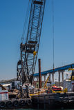 Seaport tower crane. Loading or discharging tower crane at a sea port Royalty Free Stock Images