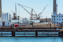 Seaport tower crane. Loading or discharging tower crane at a sea port Stock Photo
