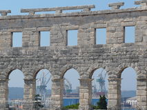 Seaport through windows of the Arena of Pula Royalty Free Stock Images