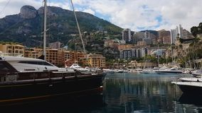 Seaport with yachts and boats under mountain, holidays in small resort town. Stock footage stock footage