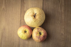 Sear apple and chinese pear on wood background. Photo royalty free stock images