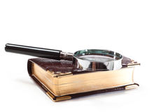 Search. Book and magnifying glass on a white background Royalty Free Stock Image