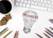 SEARCH bulb word cloud. White office desk.  Royalty Free Stock Image