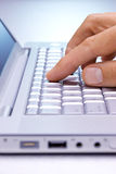 Search Computer Keys Hand. A mans hand pushing the keys on a laptop computer Royalty Free Stock Images