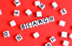 Search concept with cubes `Search` word and other defocused cubes. Search concept with cubes `Search` word and other defocused cubes royalty free stock images