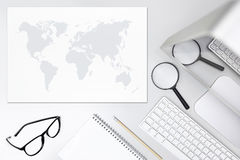 Search concept, desk with magnifying glass,computer and map Stock Photography