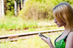 Search for connection. A woman looking at phone Royalty Free Stock Images
