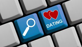Search for Dating online - Computer Keyboard. Computer Keyboard with symbols is showing search for Dating online Stock Image