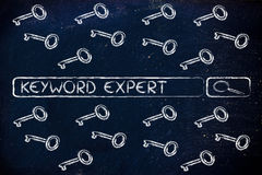 Search engine bar with tags about Keyword experts, surrounded by Royalty Free Stock Photo