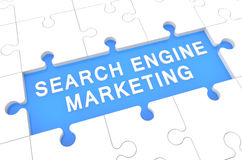 Search Engine Marketing. Puzzle 3d render illustration with word on blue background Royalty Free Stock Image