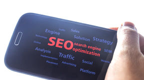 Search Engine Optimization. Concept background ,hand holding a smart phone Stock Photos