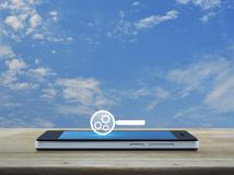 Search engine optimization concept. Seo flat icon on modern smart phone screen on wooden table over blue sky with white clouds, Search engine optimization Stock Images