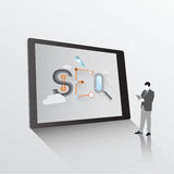 Search engine optimization graphic on tablet with businessman Stock Images