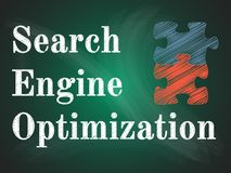 Search engine optimization puzzle. SEO puzzle on green blackboard Stock Photography