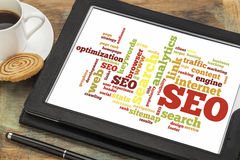Search engine optimization - SEO. Cloud of words or tags related to SEO (search engine optimization) on a digital tablet stock photos