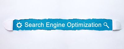 Search Engine Optimization text on torn paper. royalty free illustration
